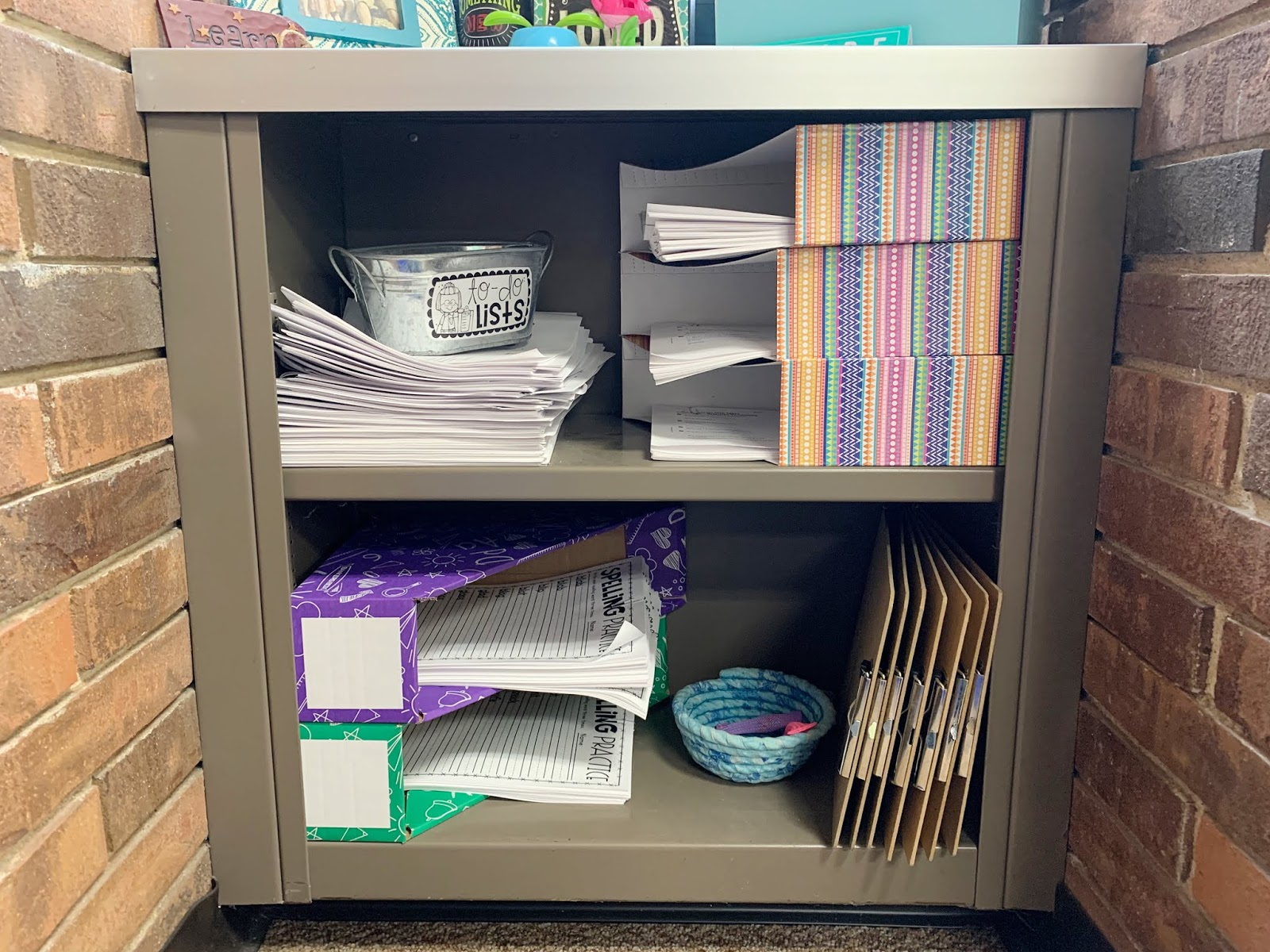 Image of shelf with multiple papers organized in folders