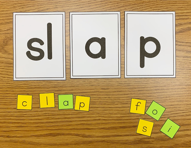 Image of a Desk with the Word Slap on Three Cards with Letter Tiles Underneath