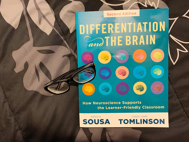 """Image of Glasses and a Book Titled """"Differentiation and the Brain"""""""